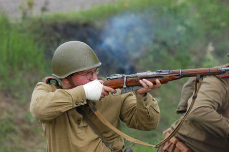 KIEV, UKRAINE, 10 MAY 2008: Member of military history club Red Star. People in Soviet WW2 military uniform. Historical military reenacting in Kiev, Ukraine. 8-10 May 2008.  Stock Photo - 9004077
