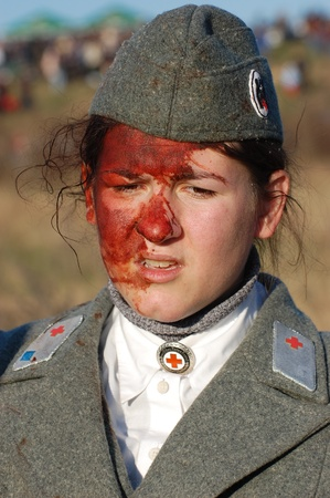 KIEV,UKRAINE. 9 November 2008 Person in German WW2 military German nurse uniform. Member of military history club Red Star. HHistorical military reenacting in Kiev, Ukraine on November 7-9, 2008