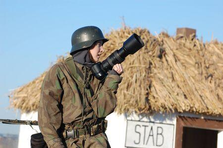 KIEV,UKRAINE - 8 NOV 2008: Woman in  WW2 military German nurse uniform. Member of military history club Red Star. Historical military reenacting in Kiev, Ukraine on November 7-9, 2008.