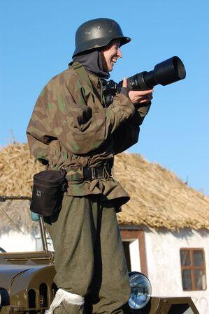 2008: Woman in  WW2 military German nurse uniform. Member of military history club Red Star. Historical military reenacting in Kiev, Ukraine on November 7-9, 2008.  Stock Photo - 9004084