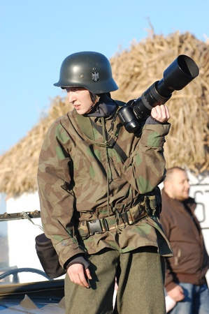 2008: Woman in  WW2 military German nurse uniform. Member of military history club Red Star. Historical military reenacting in Kiev, Ukraine on November 7-9, 2008.