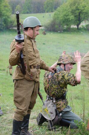 KIEV, UKRAINE, 10 MAY 2008: Member of military history club Red Star. People in Soviet WW2 military uniform.Take prisoner. Historical military reenacting in Kiev, Ukraine. 8-10 May 2008 Stock Photo - 9004196