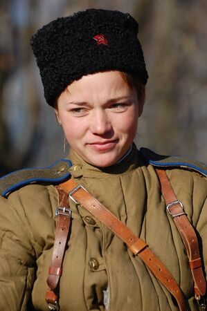 KIEV,UKRAINE - NOV 9: Person in Soviet WW2 military uniform. Member of military history club Red Star. Historical military reenacting Kiev ,Ukraine. 7-9 November 2008