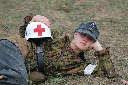 KIEV, UKRAINE - MAY 10 : member of Red Star history club wears historical military German paramedic uniform during historical reenactment of 1945 WWII, May 10, 2010 in Kiev, Ukraine