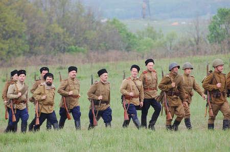 re enacting: KIEV, UKRAINE - MAY 10 : Members of Red Star history club wear historical Soviet uniform during historical reenactment of 1945 WWII, May 10, 2010 in Kiev, Ukraine  Editorial