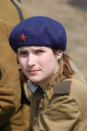KIEV, UKRAINE - MAY 10 : A member of Red Star history club wears historical Soviet uniform during historical reenactment of 1945 WWII, May 10, 2010 in Kiev, Ukraine