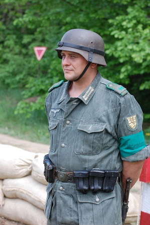 KIEV, UKRAINE - MAY 10 : A member of Red Star history club wears historical German uniform during historical reenactment of 1945 WWII, May 10, 2010 in Kiev, Ukraine