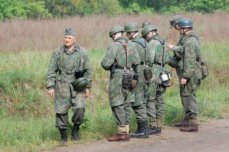 wwii: KIEV, UKRAINE - MAY 10 : members of Red Star history club wear historical German uniform during historical reenactment of 1945 WWII, May 10, 2010 in Kiev, Ukraine