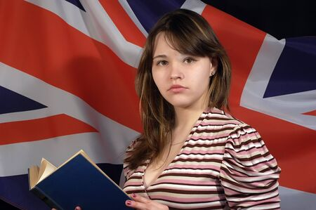 Pretty girl with book and British Flag photo