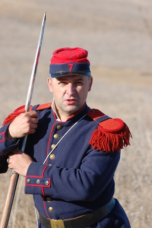 re enacting: CRIMEA, UKRAINE - SEPTEMBER 26: Member of military history club Red Star wears French historical uniform during historical reenactment of Crimean War September 26, 2009 in Crimea, Ukraine