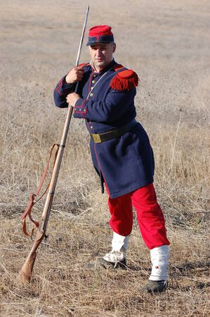 re enaction: CRIMEA, UKRAINE - SEPTEMBER 26: Member of military history club Red Star wears French historical uniform during historical reenactment of Crimean War September 26, 2009 in Crimea, Ukraine