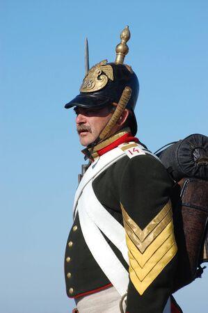 re enacting: CRIMEA, UKRAINE - SEPTEMBER 26: Member of military history club ALMA wears Russian historical uniform during historical reenactment of Crimean War September 26, 2009 in Crimea, Ukraine