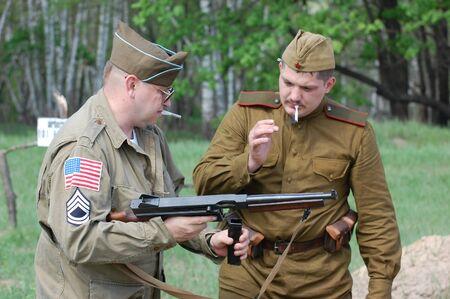 re enacting: KIEV, UKRAINE - MAY 10 : members of Red Star history club wear historical American&Soviet uniforms during participation in 1945 WWII reenactment May 10, 2010 in Kiev, Ukraine