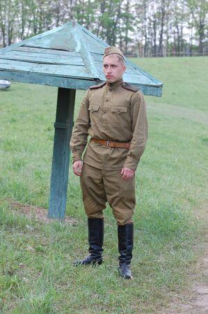 re enacting: KIEV, UKRAINE - MAY 10 : A member of Red Star history club wears historical Soviet uniform during historical reenactment of 1945 WWII, May 10, 2010 in Kiev, Ukraine