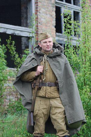 re enacting: KIEV, UKRAINE - MAY 6 : A member of Red Star history club wears historical Soviet uniform during historical reenactment of WWII, May 6, 2011 in Kiev, Ukraine  Editorial
