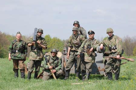 re enacting: KIEV, UKRAINE - MAY 8 : Members of Red Star history club wear historical German uniform during historical reenactment of WWII on May 8, 2011 in Kiev, Ukraine