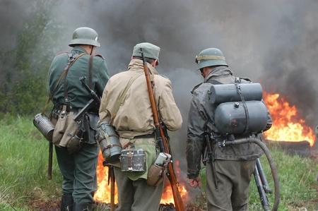 re enacting: KIEV, UKRAINE - MAY 6 : Members of Red Star history club wear historical German uniform during historical reenactment of WWII, May 6, 2011 in Kiev, Ukraine  Editorial
