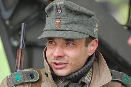 reenactmant: KIEV, UKRAINE - MAY 6 : Member of Red Star history club wears historical German uniform during historical reenactment of WWII, May 6, 2011 in Kiev, Ukraine
