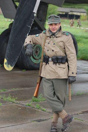 KIEV, UKRAINE - MAY 6 : Member of Red Star history club wears historical German uniform during historical reenactment of WWII, May 6, 2011 in Kiev, Ukraine  Stock Photo - 9475424