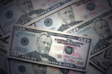 heap of fifty dollars background  photo