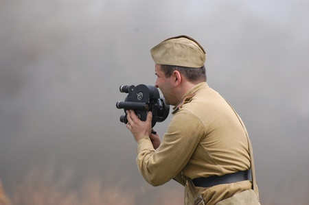 bullet camera: KIEV, UKRAINE - MAY 8 : A member of Red Star history club wears historical Soviet uniform during historical reenactment of WWII on May 8, 2011 in Kiev, Ukraine  Editorial