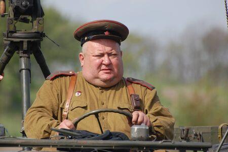 re enacting: KIEV, UKRAINE - MAY 8 : A member of Red Star history club wear historical Soviet uniform during historical reenactment of WWII on May 8, 2011 in Kiev, Ukraine