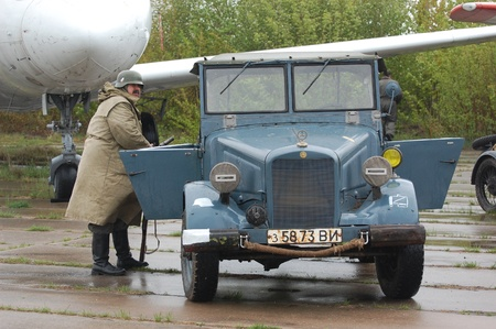 re enacting: KIEV, UKRAINE - MAY 6 : Members of Red Star history club & German military jeep  during historical reenactment of WWII on May 6, 2011 in Kiev, Ukraine  Editorial