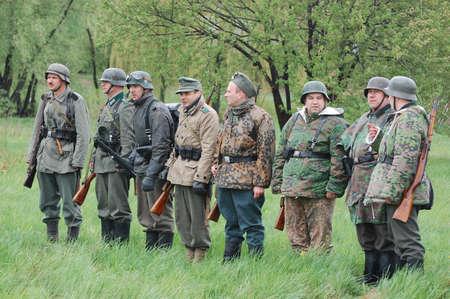 re enacting: KIEV, UKRAINE - MAY 6 : Members of Red Star history club wear historical German uniform during historical reenactment of WWII on May 6, 2011 in Kiev, Ukraine  Editorial