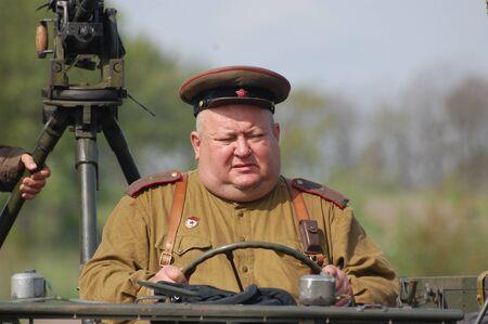 KIEV, UKRAINE - MAY 8 : A member of Red Star history club wears historical Soviet uniform during historical reenactment of WWII on May 8, 2011 in Kiev, Ukraine