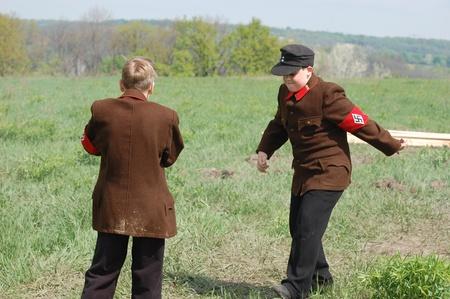 reenactmant: KIEV, UKRAINE - MAY 8 : Members of Red Star history club wear historical German uniform during historical reenactment of WWII on May 8, 2011 in Kiev, Ukraine