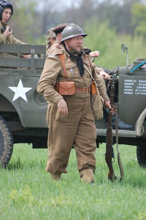 reenactmant: KIEV, UKRAINE - MAY 8 : An unidentified member of Red Star history club wears historical French  uniform during historical reenactment of WWII on May 8, 2011 in Kiev, Ukraine