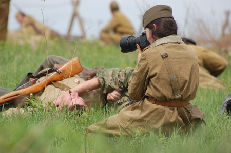 bullet camera: KIEV, UKRAINE - MAY 8 : An unidentified member of Red Star history club wears historical Soviet uniform during historical reenactment of WWII on May 8, 2011 in Kiev, Ukraine