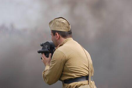 re enacting: KIEV, UKRAINE - MAY 8 : An unidentified member of Red Star history club wears historical Soviet uniform during historical reenactment of WWII on May 8, 2011 in Kiev, Ukraine
