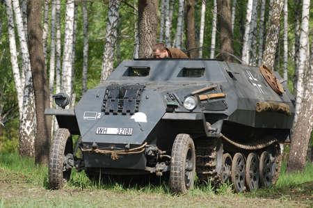 re enaction: KIEV, UKRAINE - MAY 8 : German armored truck during historical reenactment of WWII on May 8, 2011 in Kiev, Ukraine  Editorial