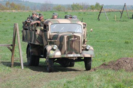 re enaction: KIEV, UKRAINE - MAY 8 : German truck of WWII time during historical reenactment of WWII on May 8, 2011 in Kiev, Ukraine