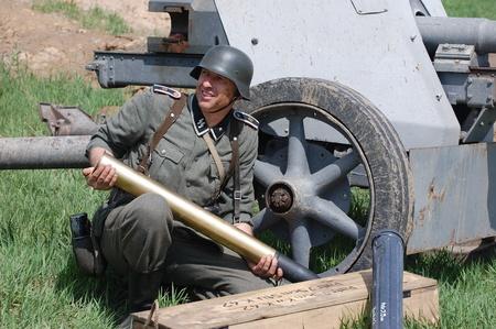 re enacting: KIEV, UKRAINE - MAY 8 : Member of Red Star history club wears historical German uniform during historical reenactment of WWII on May 8, 2011 in Kiev, Ukraine  Editorial