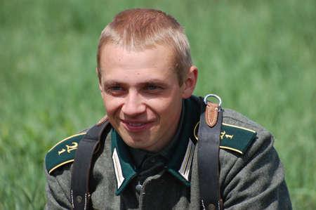 reenactmant: KIEV, UKRAINE - MAY 8 : Member of Red Star history club wears historical German uniform during historical reenactment of WWII on May 8, 2011 in Kiev, Ukraine  Editorial