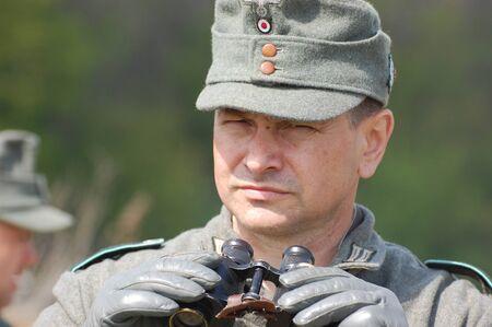 re enaction: KIEV, UKRAINE - MAY 8 : Member of Red Star history club wears historical German uniform during historical reenactment of WWII on May 8, 2011 in Kiev, Ukraine  Editorial