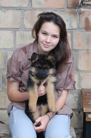 sheppard: Teenager girl and German Shepherd dog puppy