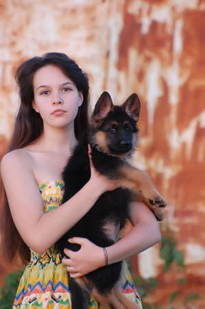Teenager girl and German Shepherd dog puppy  photo