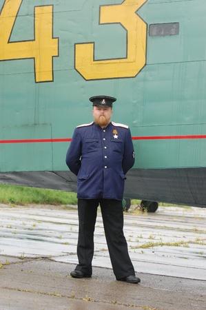 re enacting: KIEV, UKRAINE - MAY 6 : A member of Red Star history club wears historical Soviet Naval uniform during historical reenactment of WWII, May 6, 2011 in Kiev, Ukraine