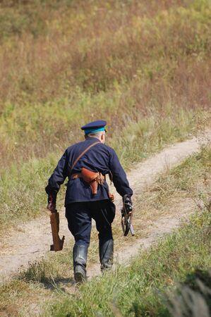 re enacting: KIEV, UKRAINE -SEPT 18 : A member of Red Star history club wears historical Soviet Police (Militia) uniform during historical reenactment of WWII, September 18, 2011 in Kiev, Ukraine