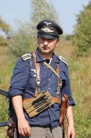 re enaction: KIEV, UKRAINE -SEPT 18 : A member of Red Star history club wears historical German uniform during historical reenactment of WWII, September 18, 2011 in Kiev, Ukraine
