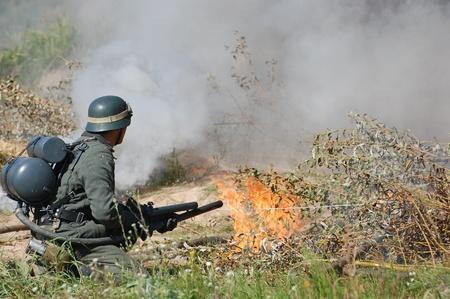 re enacting: German soldier with flame-thrower. WW2 reenactment in Kiev,Ukraine  Editorial