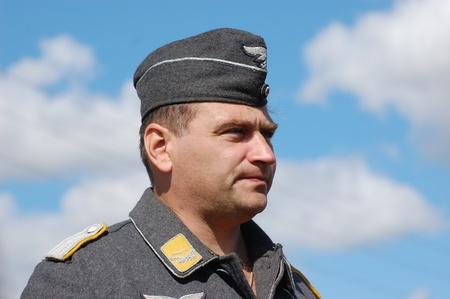 re enaction: KIEV, UKRAINE -SEPT 18 : Unidentified member of Red Star history club wears historical German Luftwaffe uniform during historical reenactment of WWII, September 18, 2011 in Kiev, Ukraine