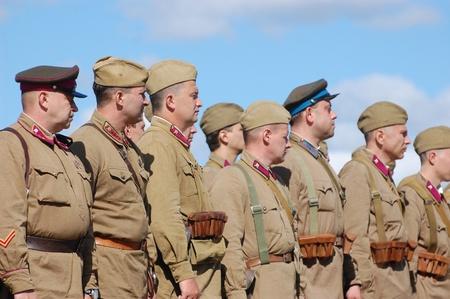 re enacting: KIEV, UKRAINE -SEPT 17 : A members of Red Star history club wear historical Soviet uniform during historical reenactment of WWII, September 17, 2011 in Kiev, Ukraine