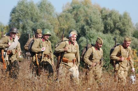 re enacting: KIEV, UKRAINE -SEPT 18 : Members of Red Star history club wear historical Soviet uniform during historical reenactment of WWII, September 18, 2011 in Kiev, Ukraine  Editorial