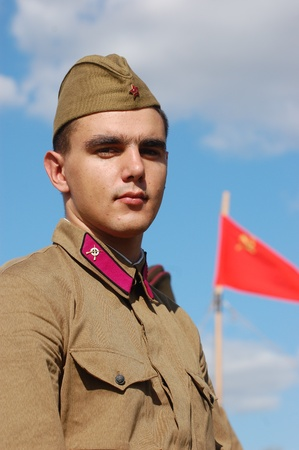 re enacting: KIEV, UKRAINE -SEPT 17 : A member of Red Star history club wears historical Soviet uniform during historical reenactment of WWII, September 17, 2011 in Kiev, Ukraine