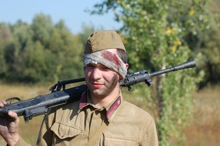 re enacting: KIEV, UKRAINE -SEPT 18 : A member of Red Star history club wears historical Soviet uniform during historical reenactment of WWII, September 18, 2011 in Kiev, Ukraine