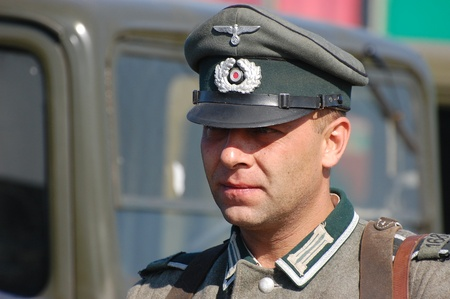 re enaction: KIEV, UKRAINE -SEPT 18 : Member of Red Star history club wears historical German uniform during historical reenactment of WWII, September 18, 2011 in Kiev, Ukraine